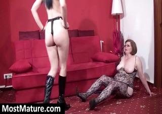 Mature mom in body stocking sucks strapon and